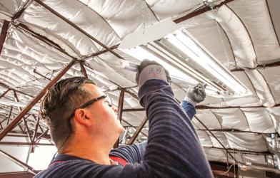 Man replacing fluorescent bulbs