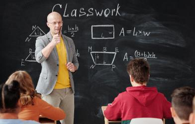 Teacher teaching students in classroom